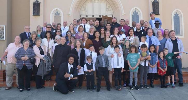 fam in front of church